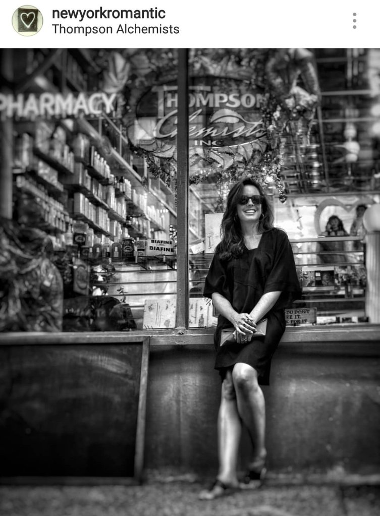 a artist takes a break in front of Thompson Chemists on historic Thompson Street