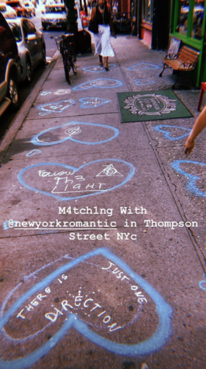 a picture of matching art work from two different artists on Thompson Street in Greenwich Village