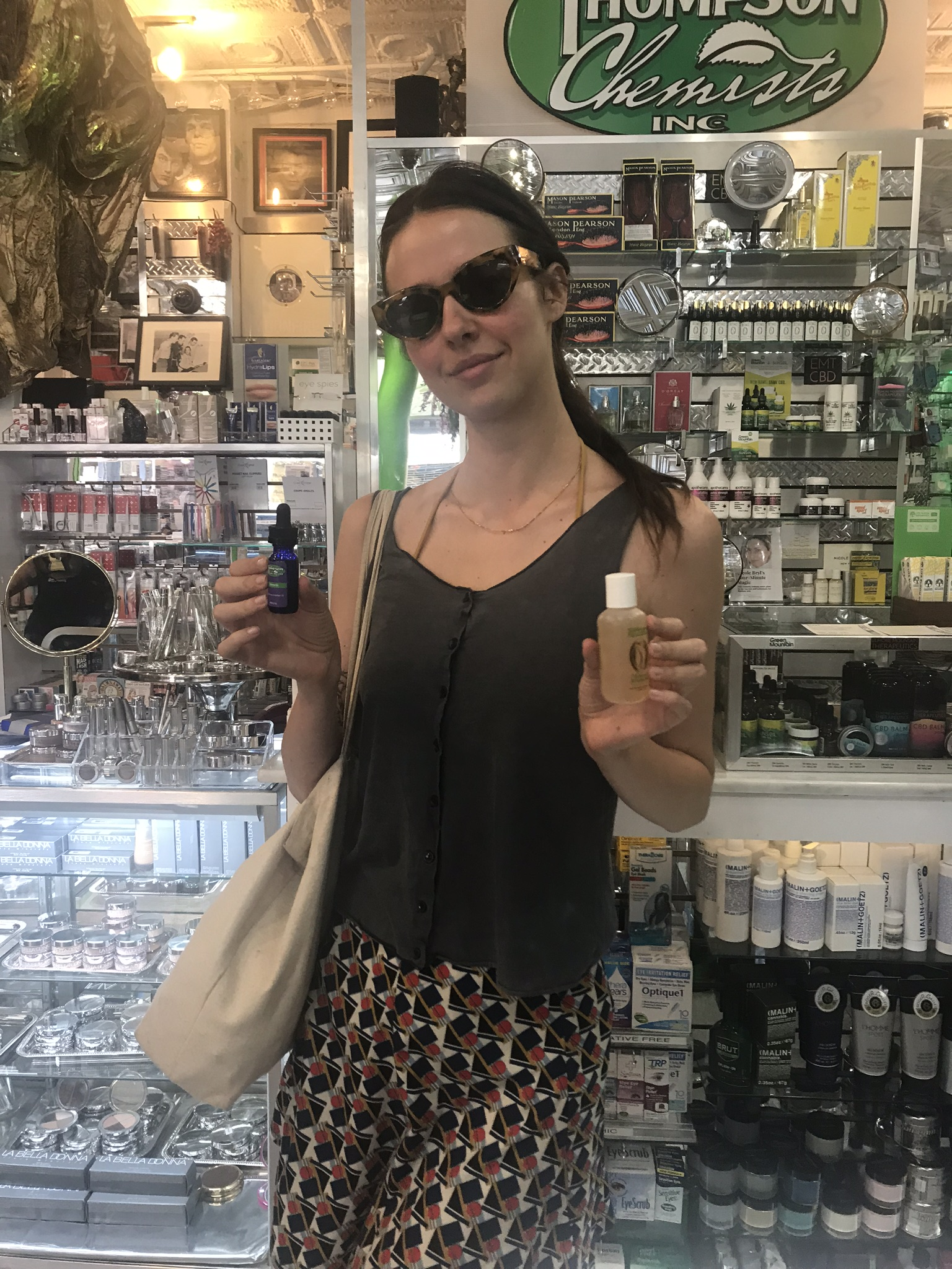 Pretty lady holding Thompson Alchemists body products