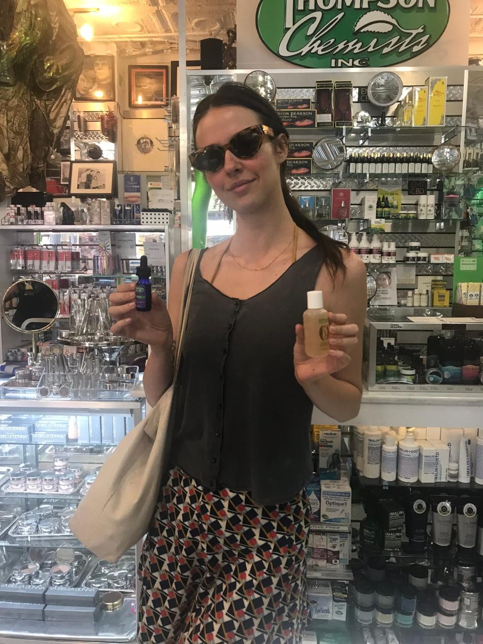 Pretty lady holding Thompson Alchemists body products