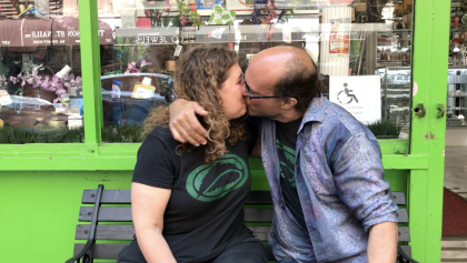 Gary the Medicine Man and Jolie, mama j showing each other love in front of their soho nyc store.