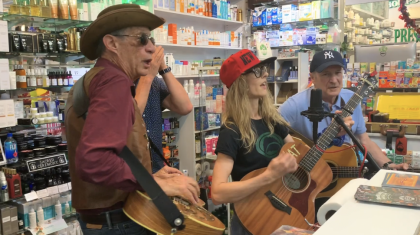 Kat Minogue Sheriff and The Deputy performing in thompson chemists pharmacy in soho ny