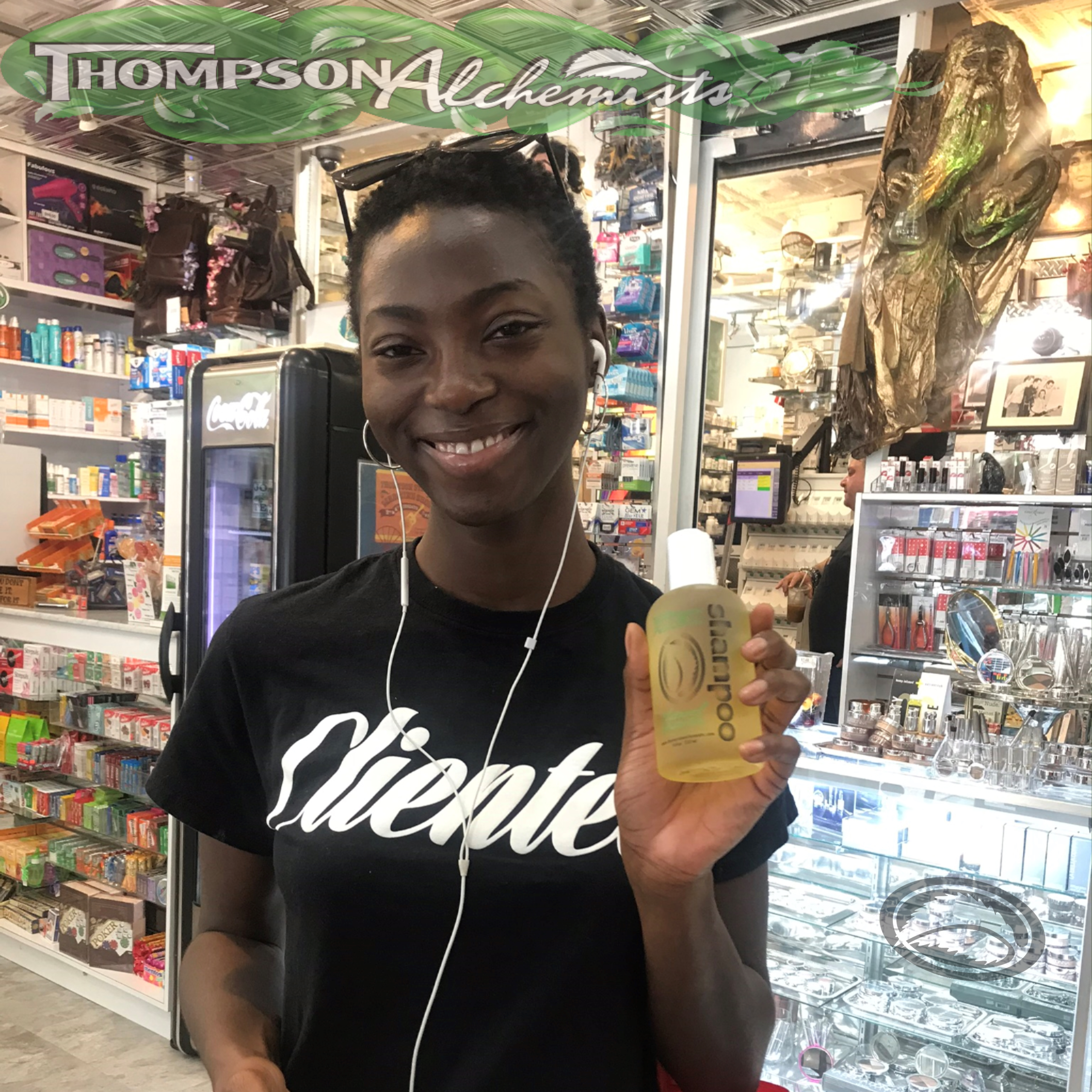 beautiful model holding Thompson Alchemists Shampoo at our Soho NYC retail store