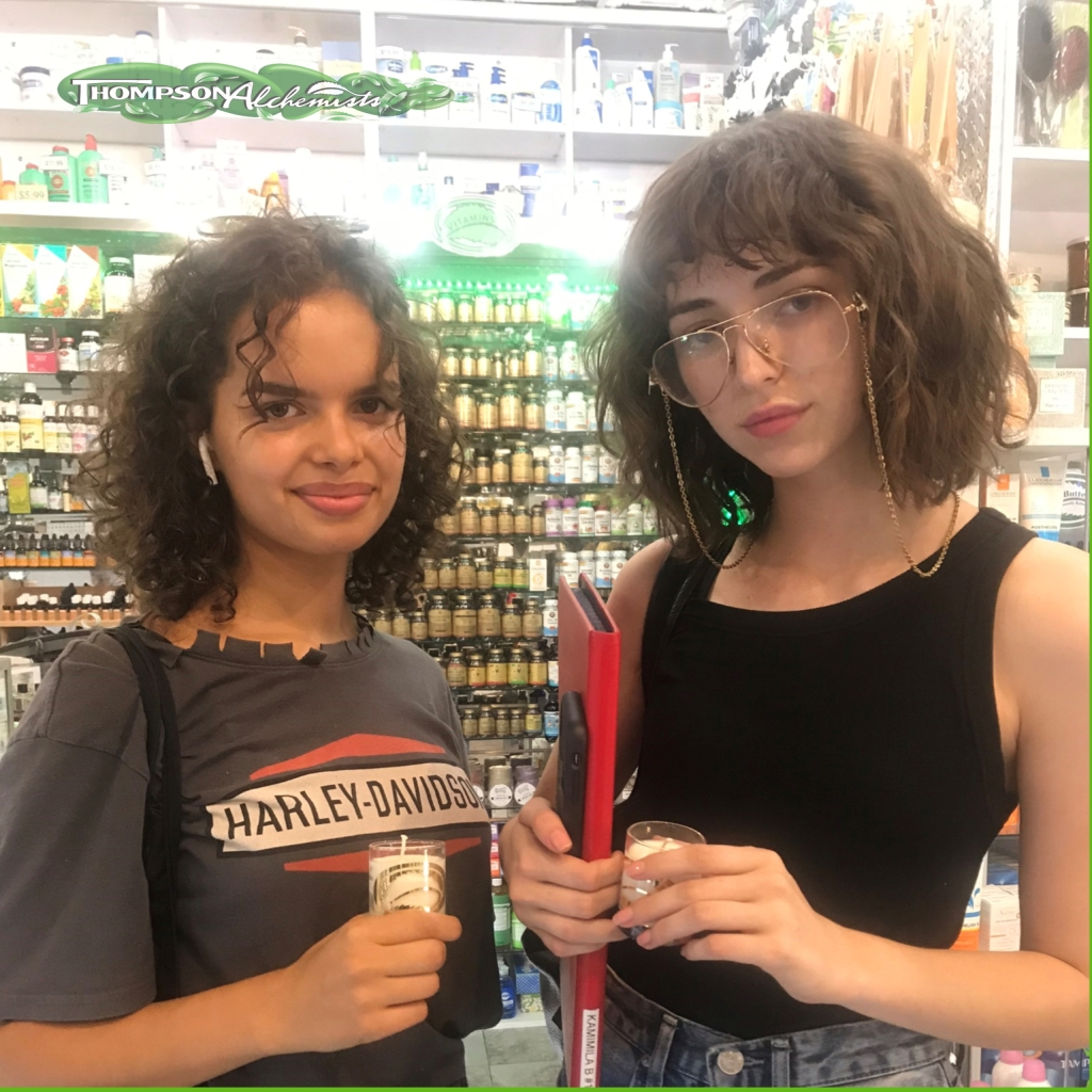 models at soho nyc thompson chemists holding thompson alchemists candles.