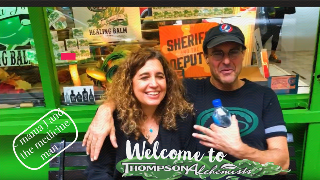 mama j and the medicine man owner of Thompson Chemists, Thompson Alchemists in front of soho nyc shop in a grateful dead cap and healing balm all around.