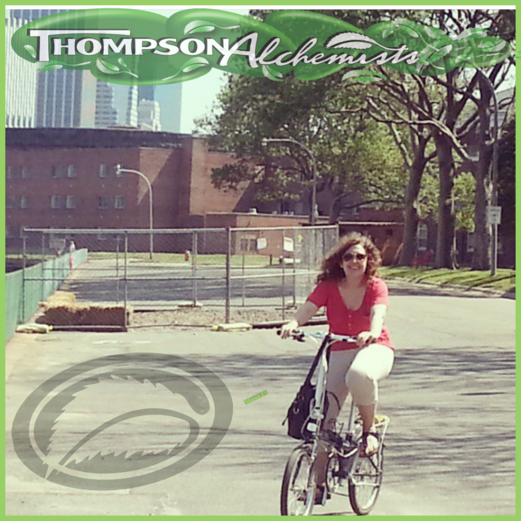 Jolie Alony thompson alchemists and thompson chemists very own riding her bike to work through NYC to historical soho, ny